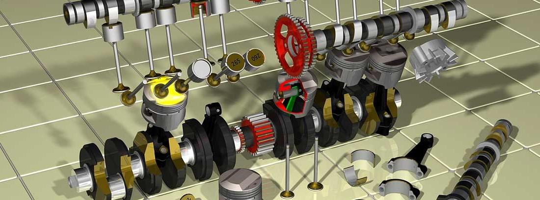 Diferentes piezas metálicas como ruedas pistones y parte de un árbol de levas
