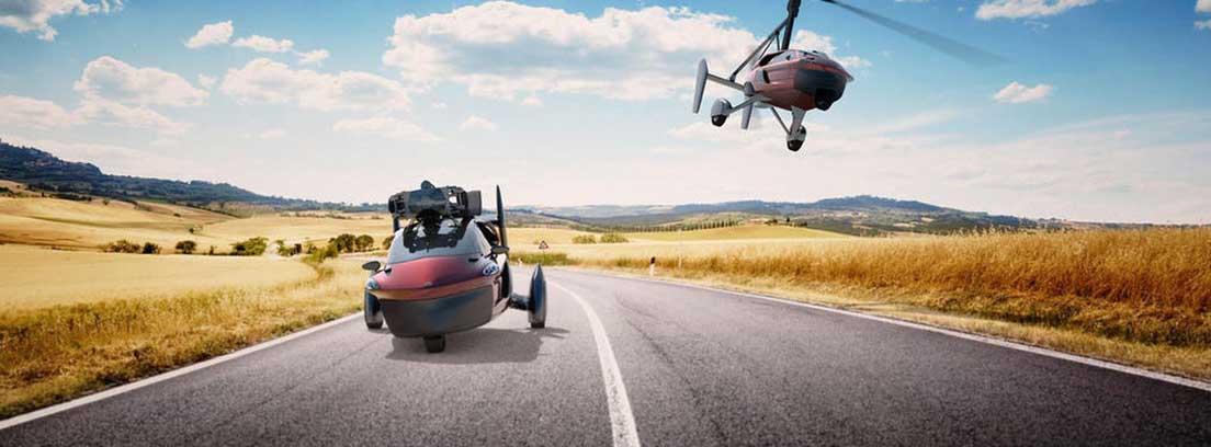 Dos unidades del coche volador circulando en carretera y en el aire