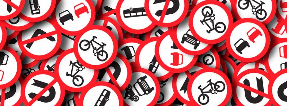 Varias señales de tráfico superpuestas