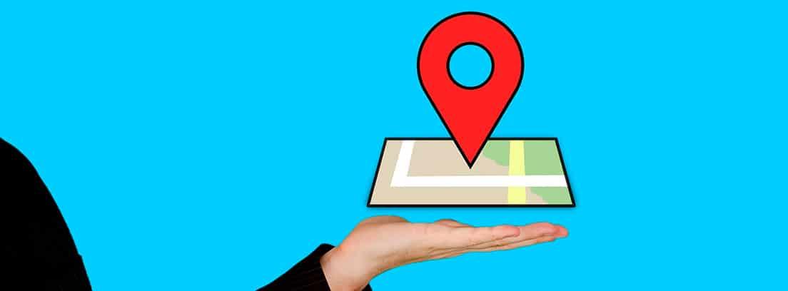 Ilustración de una mano sujetando un mapa con el símbolo de ubicación
