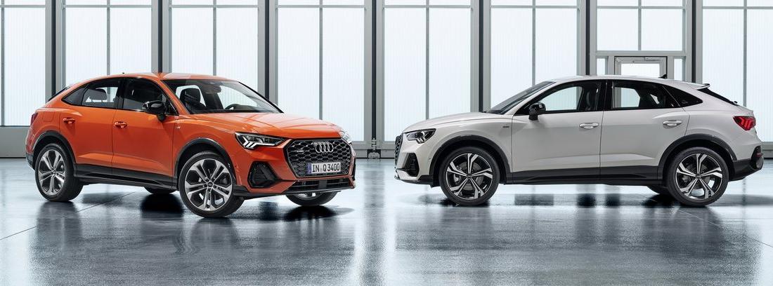 Dos modelos de Audi Q3 en naranja y gris.