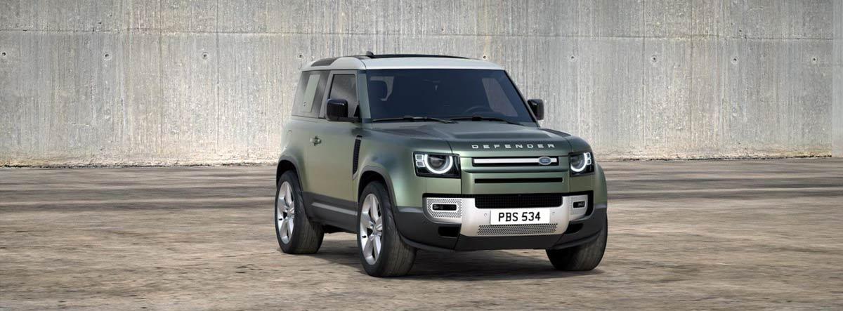 Land Rover Defender en gris aparcado