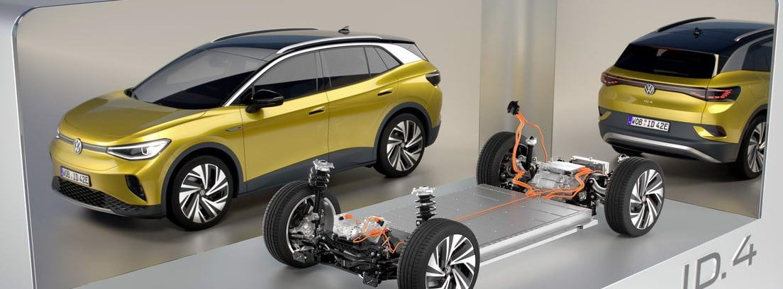 Detalle del sistema eléctrico del nuevo Volkswagen ID.4 y dos de estos vehículos alrededor