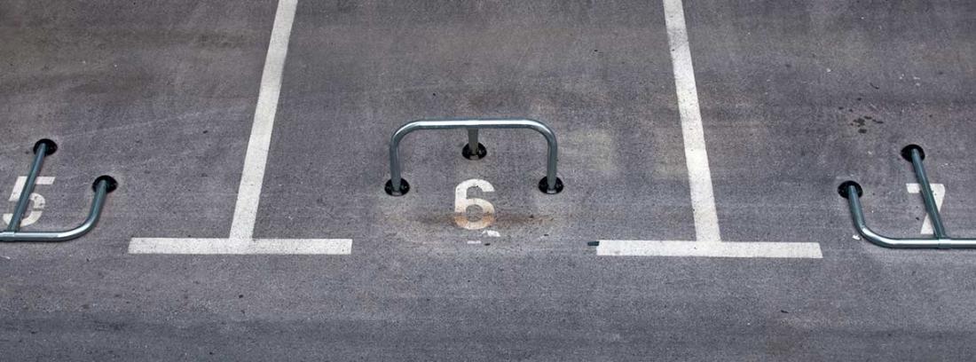 Barrera protectora de una plaza de parking